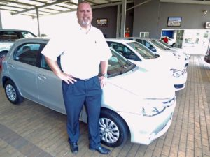CMH Nissan Highway- Grant standing with a Toyota Etios